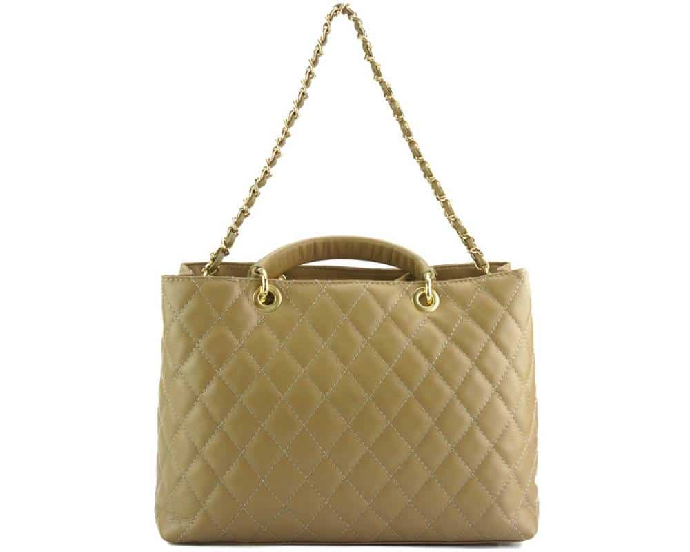 woman beige leather bag